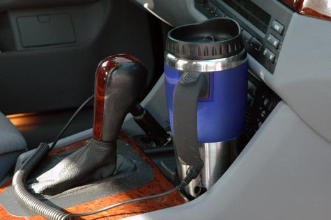 Dual Auto / USB Travel Coffee Mug keeps your drink warmer in your car.