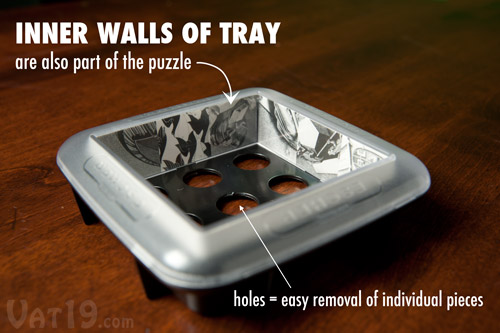 Use the inner walls of the tray to reflect parts of each M.C. Escher puzzle into the final image..