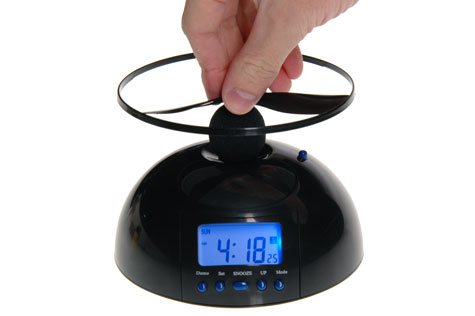 The Flying Alarm Clock features an easy-to-read backlit display