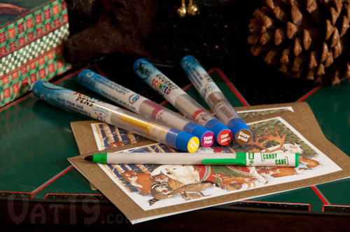 Holiday Smens Scented Pens on a table.
