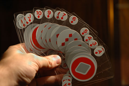 Invisible playing cards in hand.