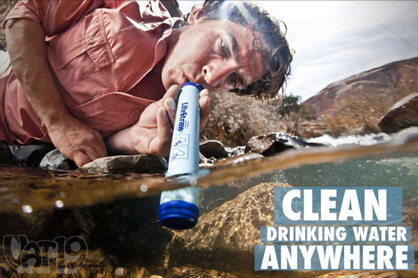 Man safely drinking water from a stream with his LifeStraw water filter.
