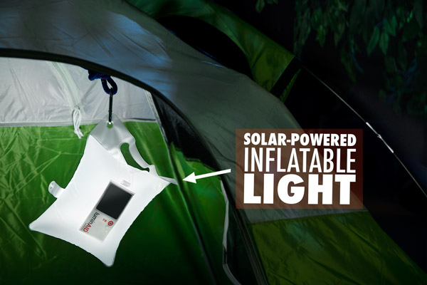 The LuminAID Solar Light hanging in a tent.