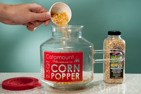 Pour the kernels into the glass microwave popcorn popper.