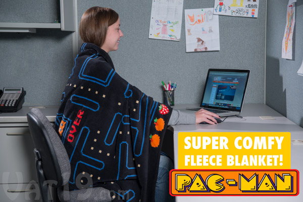 Woman enjoying a cozy web browsing experience with her plush Pac-Man Fleece Blanket.