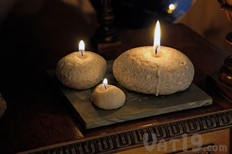 Create a rustic look inside with Pebble Candles.