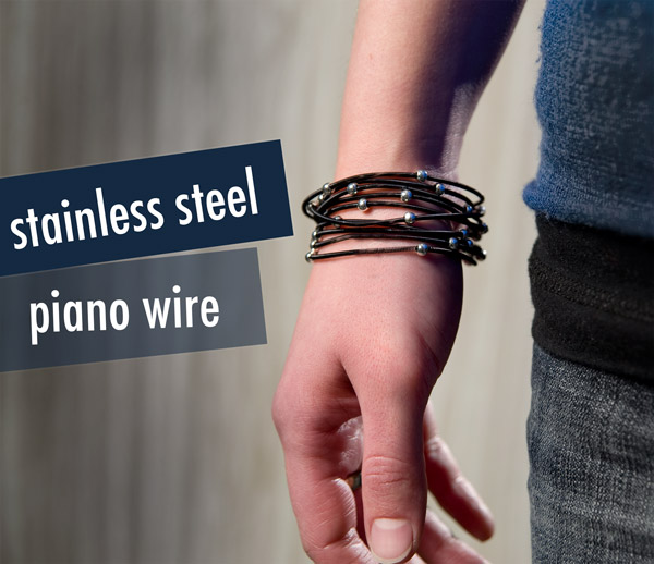 Set of 12 black and silver bracelets made from 18 gauge stainless steel piano wire.
