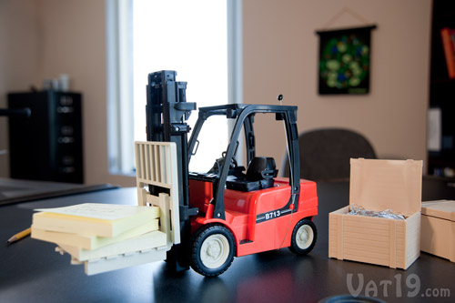 Remote Control Toy Forklift on desk.