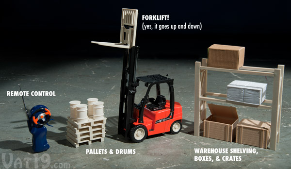 The R/C Mini Toy Forklift comes with pallets, drums, a shelving unit, boxes, and crates.