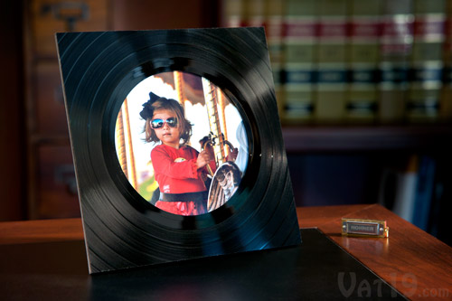 Beautiful vinyl record picture frame on a desk.
