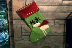 Reindeer Stocking on a fireplace mantle.