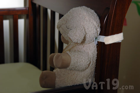 Sleep Sheep velcro strap easily attaches to bedpost or crib