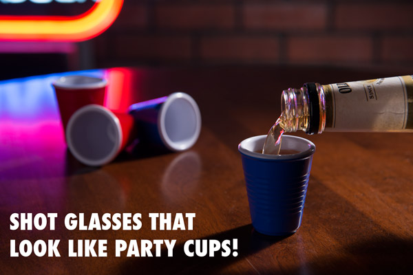 Pouring sweet whiskey into a miniature Solo Cup Shot Glass