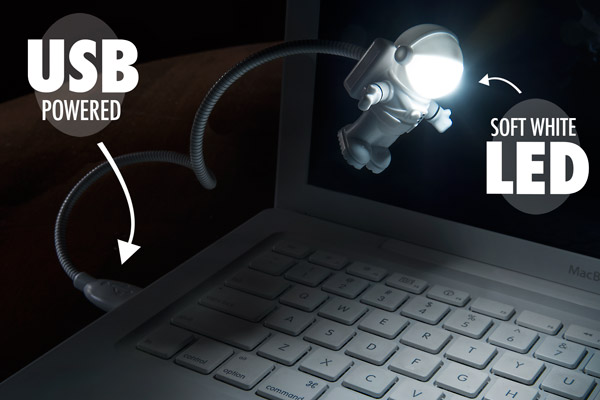 USB Spaceman Light hovering above a laptop.
