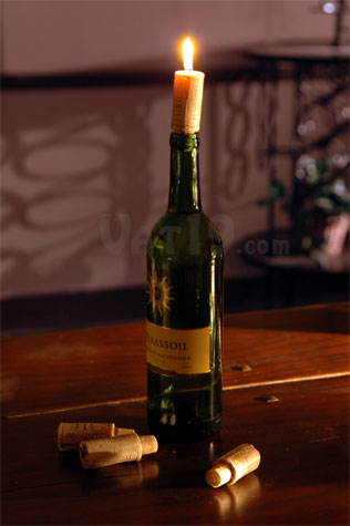 Wine cork candle on a table for How to make candle holders out of wine bottles