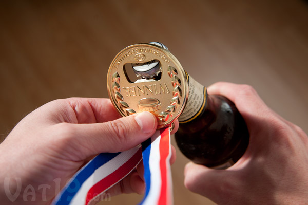 Winner Gold Medal Bottle Opener opening a beer.