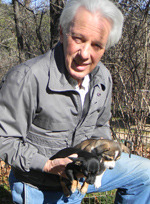 Tom Morin with puppies