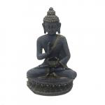 Buda com apoio para vela rezando