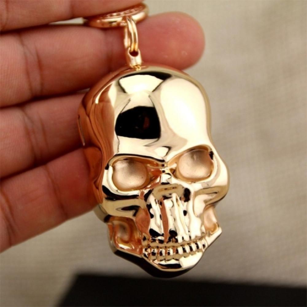 Isqueiro Elétrico Skull Dourado em Metal - 8x4 cm