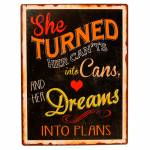 Placa She Turned Her Cants em metal - 36x27 cm
