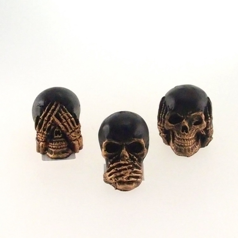 Skull cega, surda e muda dourada