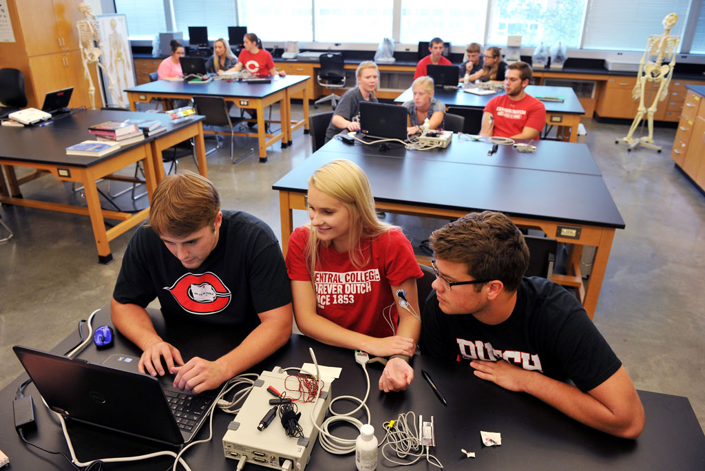 Central College students getting hands-on experience in a science lab.