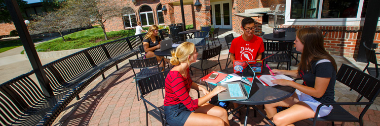 Students on the patio of Maytag Student Center.