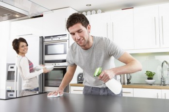 Young Couple Cleaning Kitchen