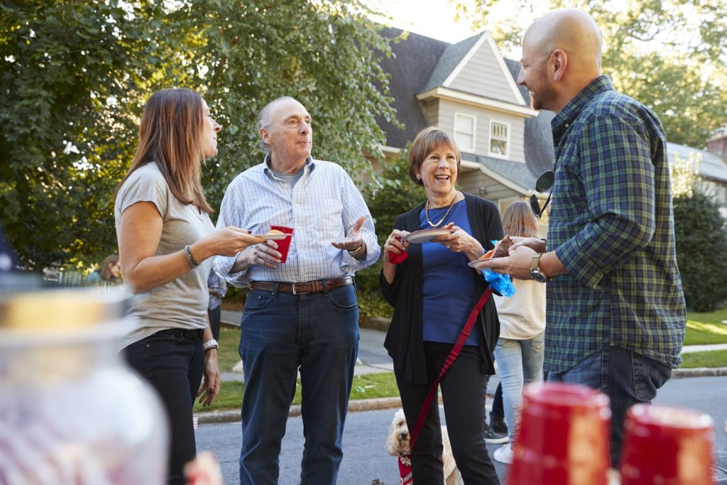 This image has an empty alt attribute; its file name is Neighbor-drinking-together-1024x683.jpeg