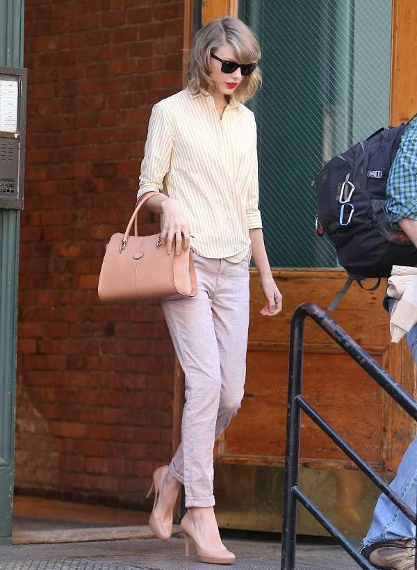 Taylor Swift ya se unió a la tendencia pastel con este outfit perfecto para trabajar. ¡No olvides el bolso!