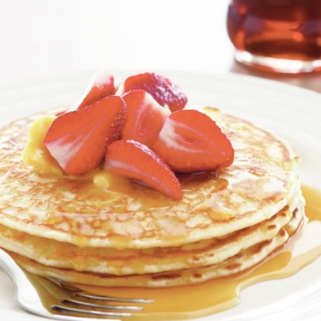 Traditional Pancakes with Maple Syrup Butter and Strawberries