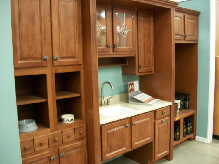 Kitchen cabinet with dishes inside.