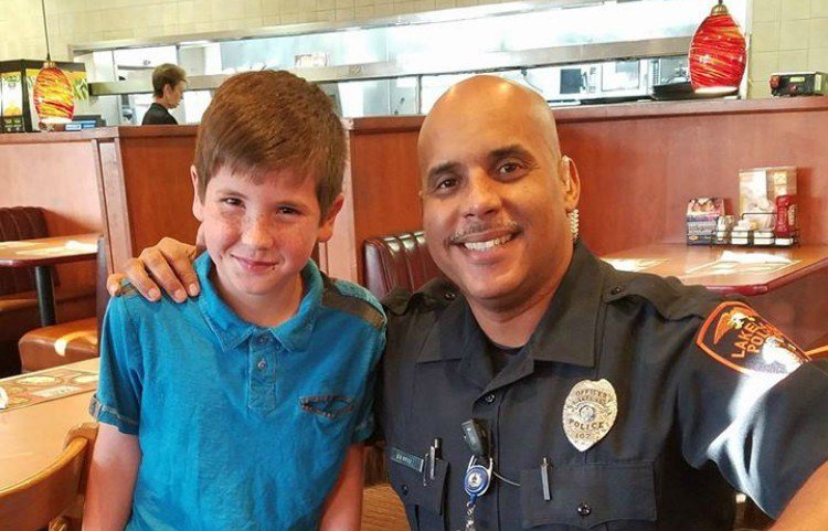Noah poses with Officer Benitez