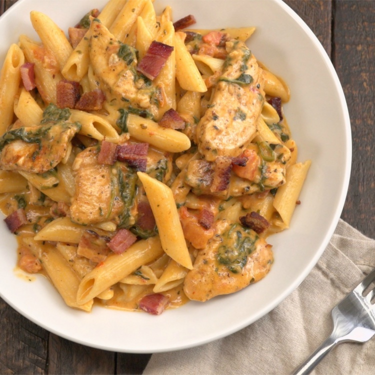 Overhead shot of bowl of creamy chicken bacon penne