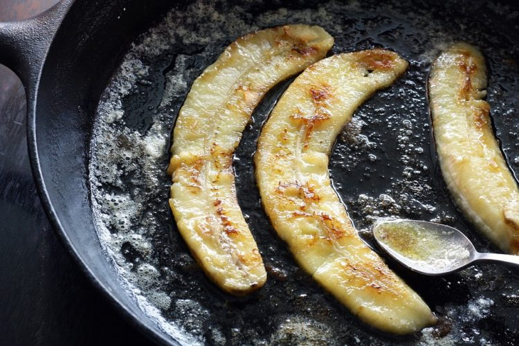 Image of cast iron pan with caramelized bananas.