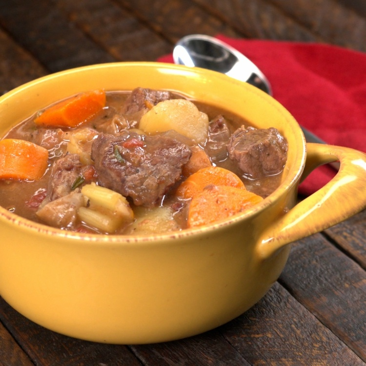 Yellow bowl of beef stew made in slow cooker