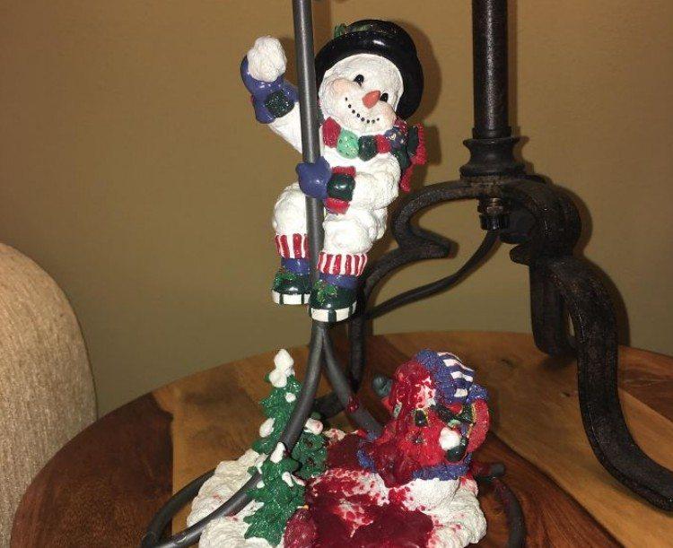 Snowman on a candle pole.