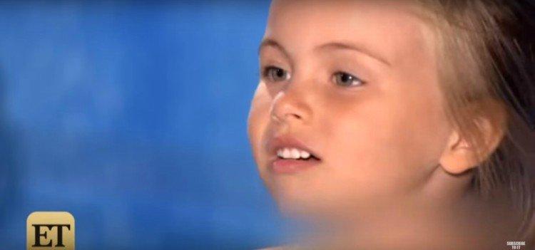 Image of little girl singing.