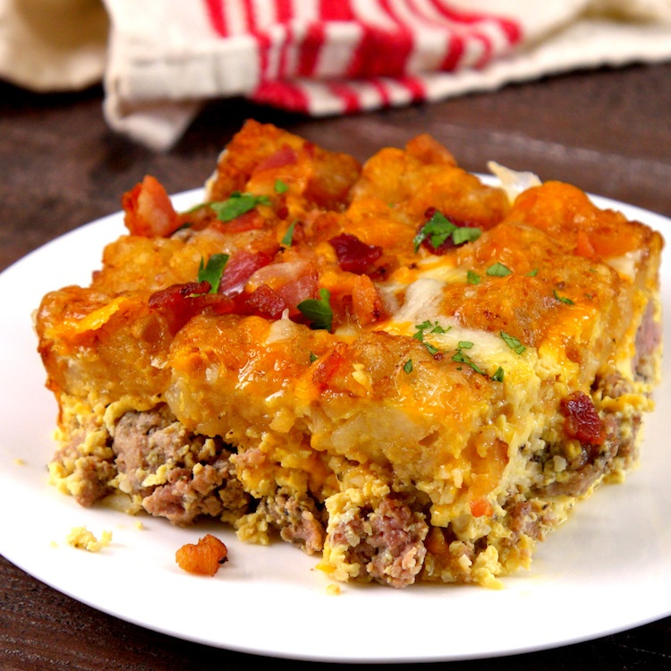 Tater tots in the AM? Yes! They're the crispy topping on this make-ahead breakfast casserole with sausage, eggs, two layers of bubbling cheese, and bacon.