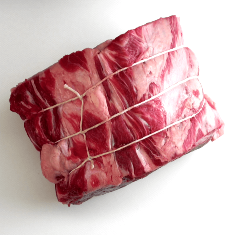 Herb and Garlic Prime Rib Roast raw meat tied with twine