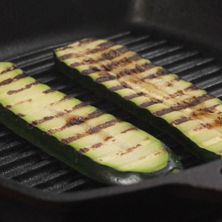 Grilling zucchini slices to make zucchini rolls