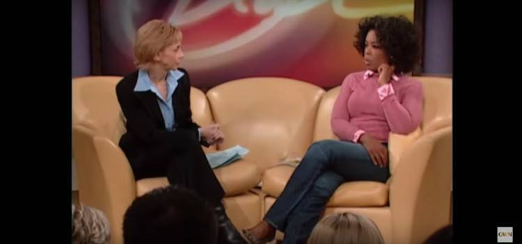 Image of Oprah speaking to doc.