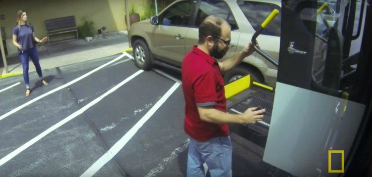 Image of driver adjusting wheelchair lift.