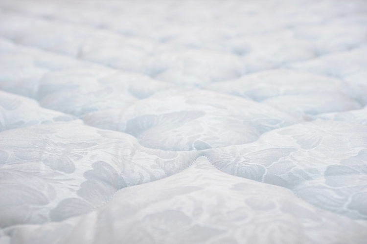 Deep clean a mattress by mixing essential oil with baking soda and massaging the mixture in