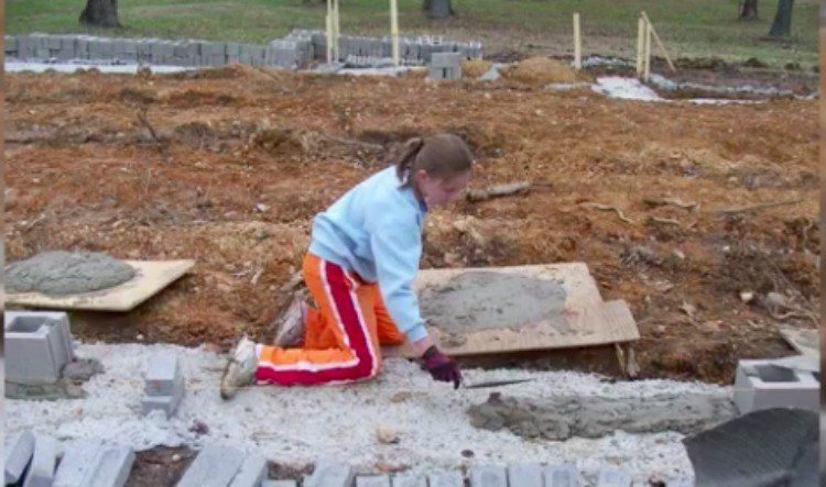 kid building the foundation of a house