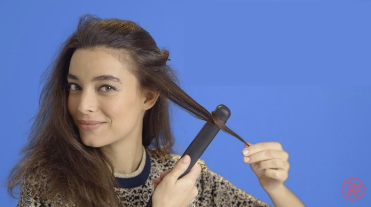 Use a flat iron to create waves in hair