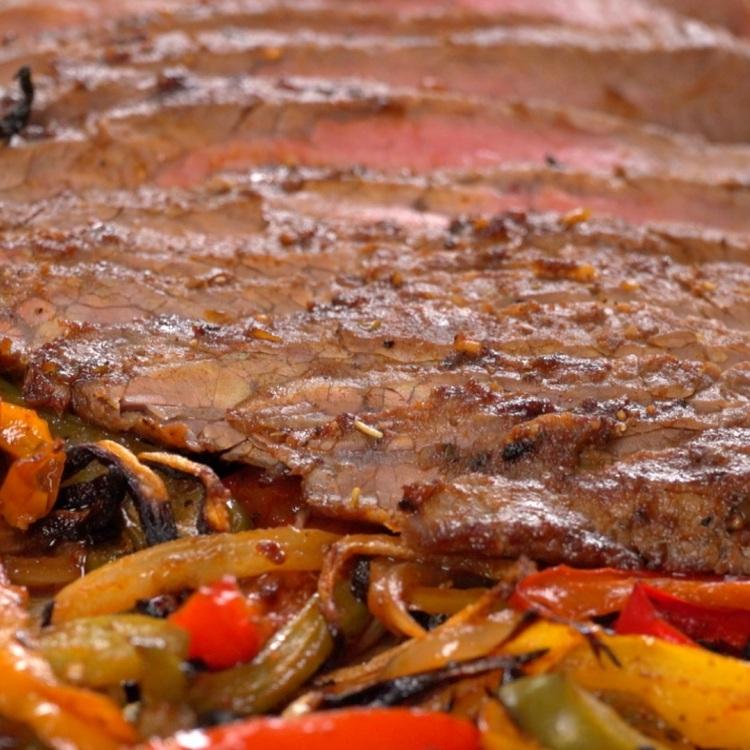 Flank steak broiled with fajita peppers