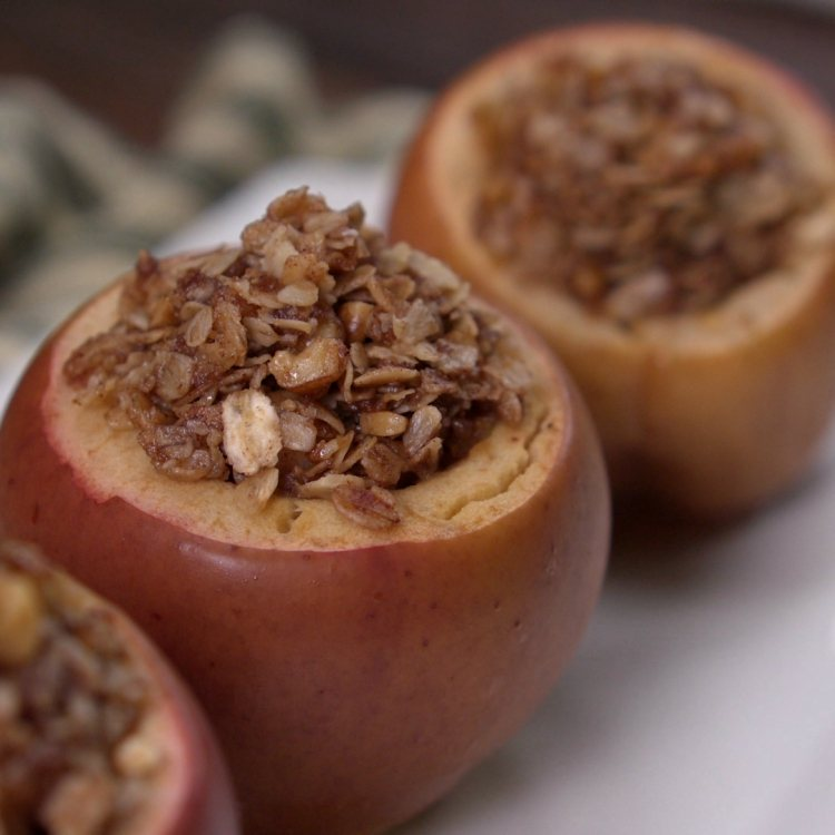 Apples baked in slow cooker stuffed with pecan rolled oat mixture