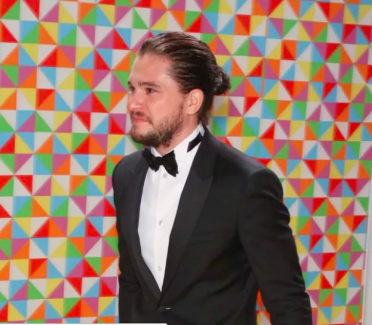 Image of man with a man bun in a suit