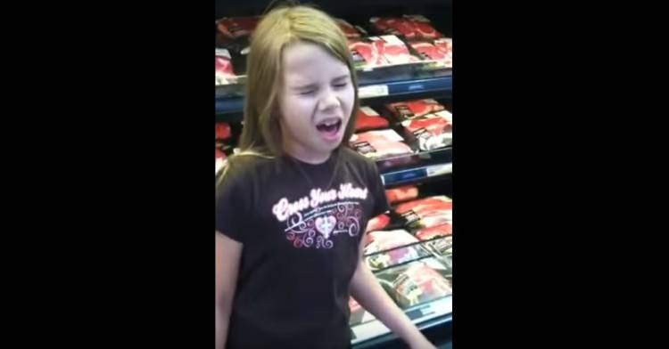 Image of girl singing in store.